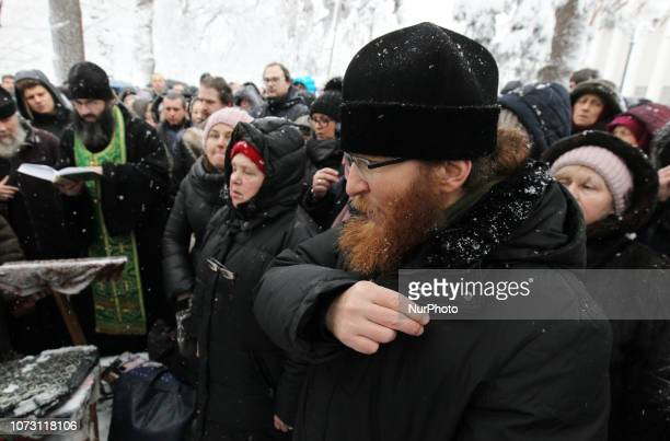 Believers of the Ukrainian Orthodox Church of the Moscow Patriarchate attend a prayer as they gather against state interference in church affairs and...