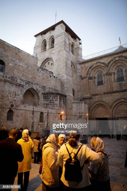 Believers on a square in front of the Church of the Holy Sepulchre historic city center of Jerusalem on February 08 2017 in Jerusalem Israel