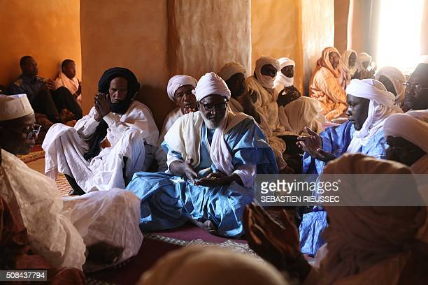 Believers pray in the Djingareyber mosque on February 4 2016 in Timbuktu during a ceremony marking the recovery of the city's historic mausoleums The...