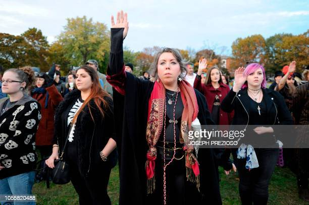Believers take part in the final parts of the Salem Witches' Magic Circle at Salem Common on Halloween in Salem MA on October 31 2018 The ceremony...