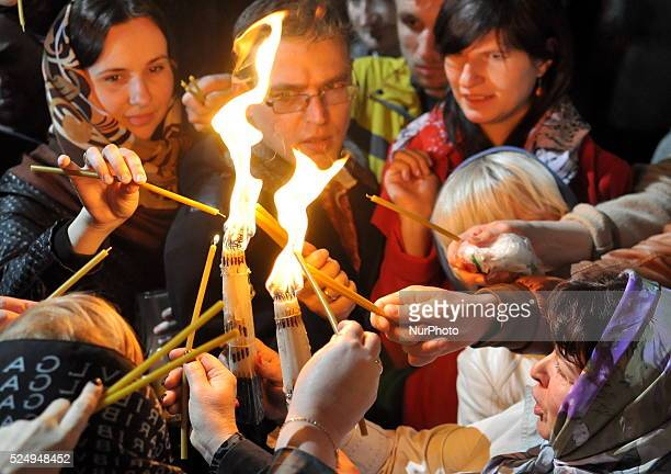 Believers take the Holy Fire from Jerusalem in Vladimir Patriarchal Cathedral Kiev Ukraine Saturday April 11 2015