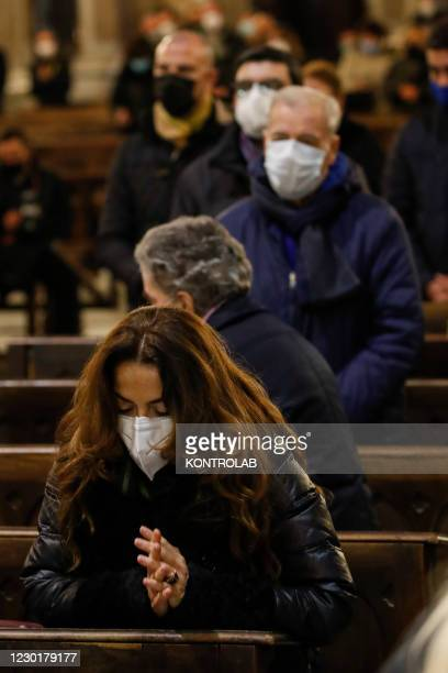 Believers wearing protective masks and social distancing in Duomo cathedral in downtown Naples City as they attend a mass.