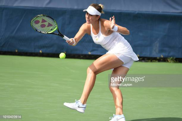 Belinda Benci of Switzerland returns a forehand shot to Andrea Petkovicof Germany during Day Seven of the Citi Open at the Rock Creek Tennis Center...