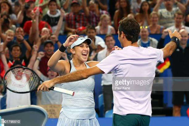 Belinda Bencic and Roger Federer of Switzerland celebrate defeating Alexander Zverev and Angelique Kerber of Germany in the final on day eight during...