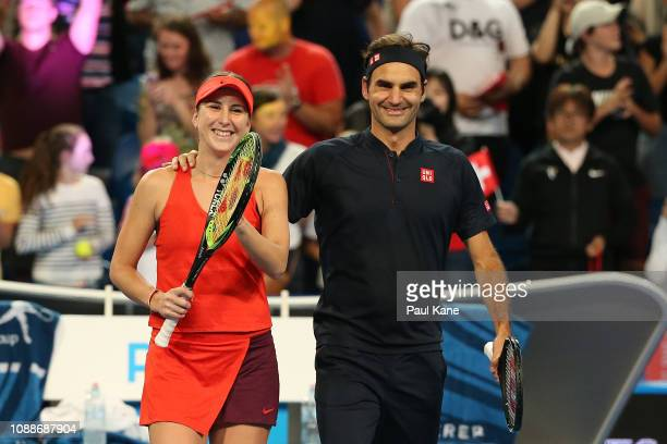 Belinda Bencic and Roger Federer of Switzerland celebrate winning the mixed doubles match against Serena Williams and Frances Tiafoe of the United...