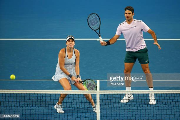 Belinda Bencic and Roger Federer of Switzerland play in the mixed doubles match against Anastasia Pavlyuchenkova and Karen Khachanov of Russia on Day...