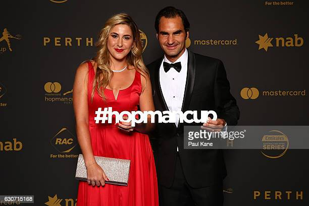 Belinda Bencic and Roger Federer of Switzerland pose on the blue carpert during the Hopman Cup New Year's Eve Gala at the Crown Perth on December 31...