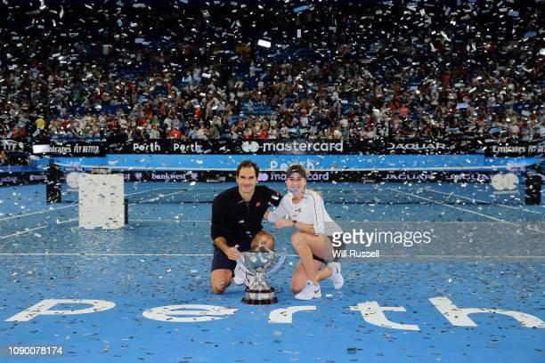 Belinda Bencic and Roger Federer of Switzerland with the Hopman Cup after defeating Angelique Kerber and Alexander Zverev of Germany in the final...