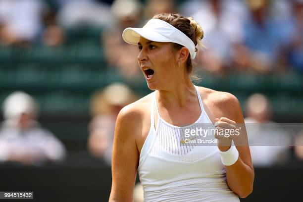 Belinda Bencic of Switzerland celebrates a point against Angelique Kerber of Germany during their Ladies' Singles fourth round match on day seven of...