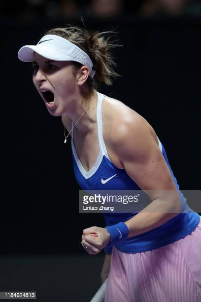 Belinda Bencic of Switzerland celebrates a point against Kiki Bertens of the Netherlands during their Women's Singles match on Day Five of the 2019...
