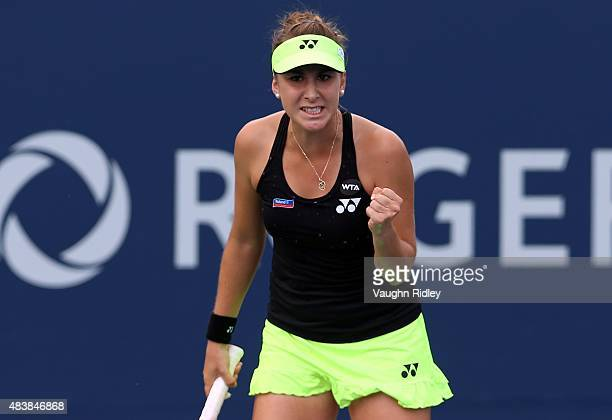 Belinda Bencic of Switzerland celebrates a point against Sabine Lisicki of Germany during Day 4 of the Rogers Cup at the Aviva Centre on August 13...