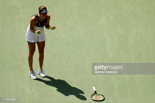 Belinda Bencic of Switzerland celebrates after winning her Women's Singles quarterfinal match against Donna Vekic of Croatia on day ten of the 2019...