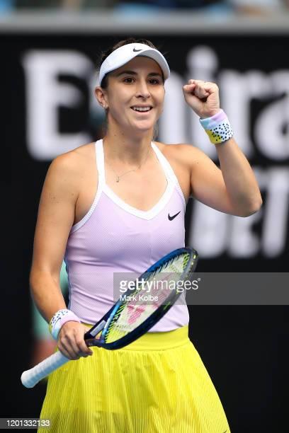 Belinda Bencic of Switzerland celebrates after winning match point during her Women's Singles second round match against Jelena Ostapenko of Latvia...