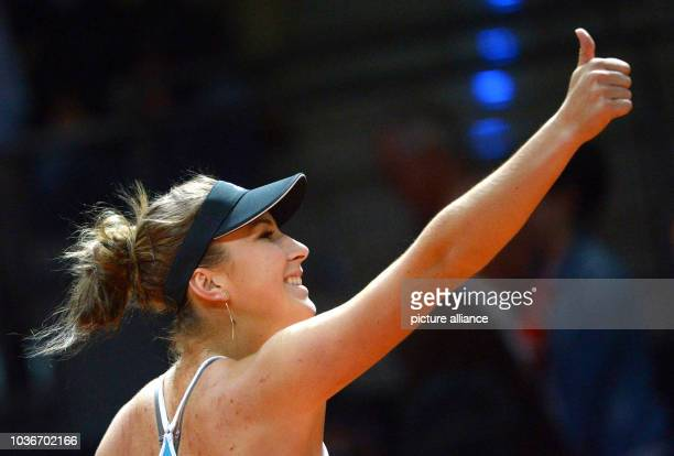 Belinda Bencic of Switzerland celebrates her victory against Goerges of Germany in the first round of the WTATennisTournament in Stuttgart Germany...