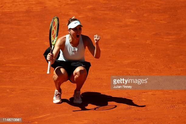 Belinda Bencic of Switzerland celebrates in her match against Simona Halep of Romania during day seven of the Mutua Madrid Open at La Caja Magica on...
