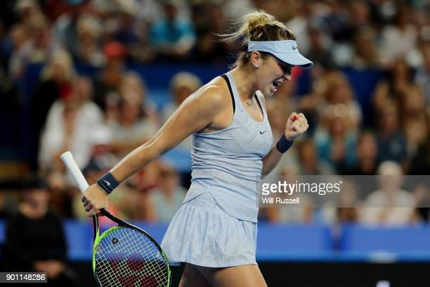 Belinda Bencic of Switzerland celebrates set point in the womens singles match against Coco Vandeweghe of the United States on day six of the 2018...
