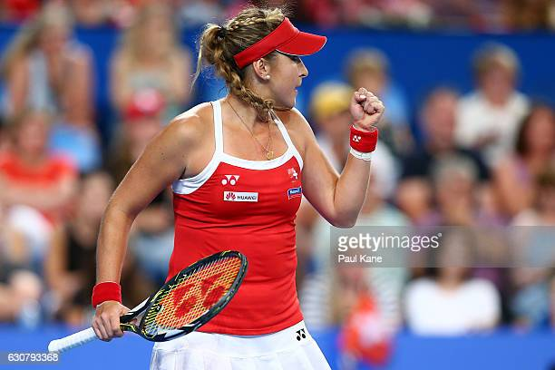 Belinda Bencic of Switzerland celebrates winning a point in the women's singles match against Heather Watson of Great Britain on day two of the 2017...