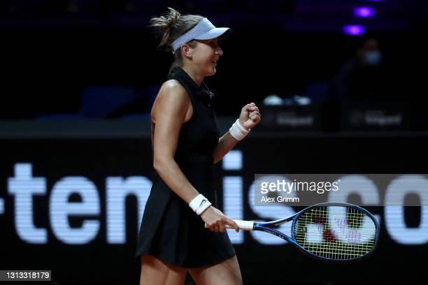 Belinda Bencic of Switzerland celebrates winning match point on day 3 of the Porsche Tennis Grand Prix match between Belinda Bencic of Switzerland...