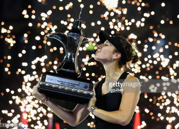 Belinda Bencic of Switzerland celebrates with the trophy after winning her Final Match against Petra Kvitova of Czech Republic on day seven of the...