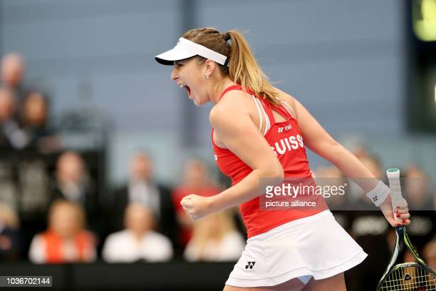 Belinda Bencic of Switzerland cheers during the match against Angelique Kerber of Germany at the Fed Cup tennis quarterfinal between Germany and...