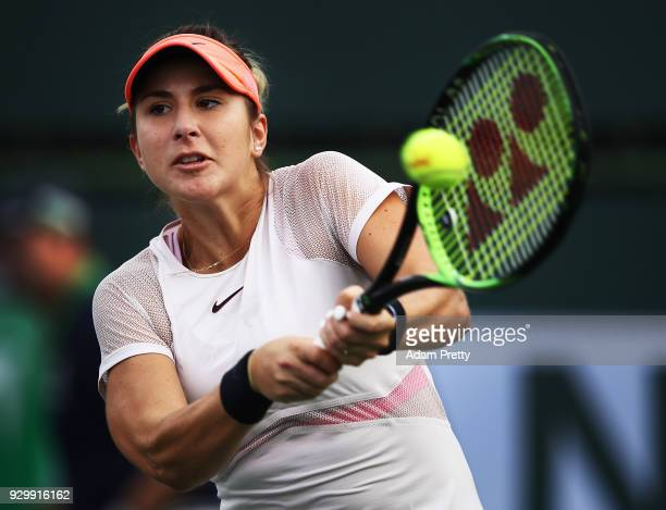 Belinda Bencic of Switzerland hits a backhand during her match against Jelena Ostapenko of Latvia during the BNP Paribas Open at the Indian Wells...