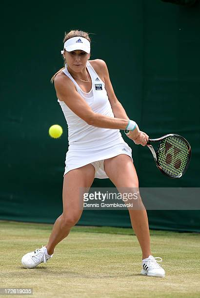 Belinda Bencic of Switzerland hits a backhand during the Girls' Singles quarter final match against Jamie Loeb of of USA on day ten of the Wimbledon...