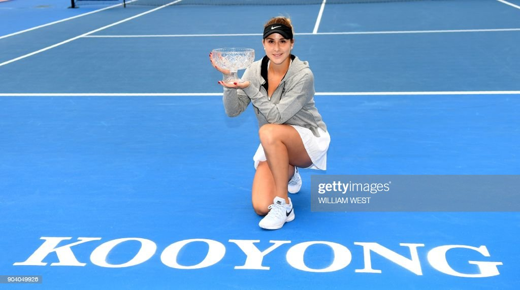 Belinda Bencic of Switzerland holds the trophy after defeating Andrea Petkovic of Germany during the women's singles final of the Kooyong Classic tennis tournament in Melbourne on January 12, 2018. /