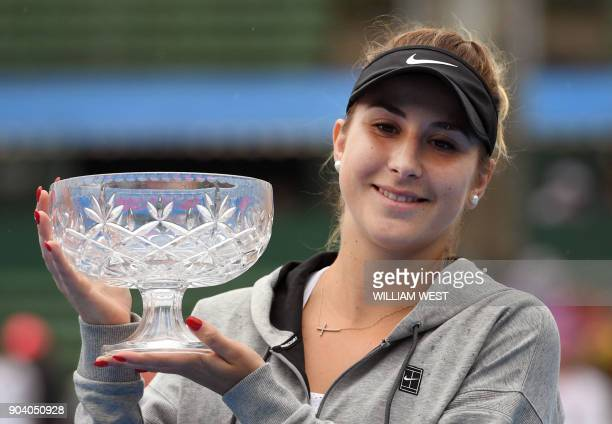 Belinda Bencic of Switzerland holds the trophy after defeating Andrea Petkovic of Germany during the women's singles final match of the Kooyong...