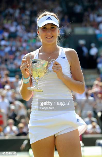 Belinda Bencic of Switzerland holds the trophy after her victory over Taylor Townsend of the USA in three sets in the Girls' Singles Final at...