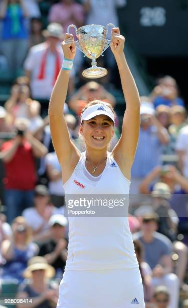 Belinda Bencic of Switzerland holds the trophy aloft after her victory over Taylor Townsend of the USA in three sets in the Girls' Singles Final at...