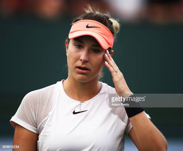 Belinda Bencic of Switzerland is dejected during her match against Jelena Ostapenko of Latvia during the BNP Paribas Open at the Indian Wells Tennis...