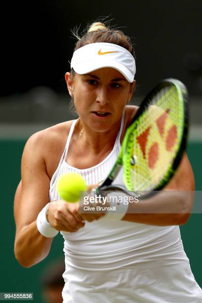 Belinda Bencic of Switzerland plays a backhand against Angelique Kerber of Germany during their Ladies' Singles fourth round match on day seven of...