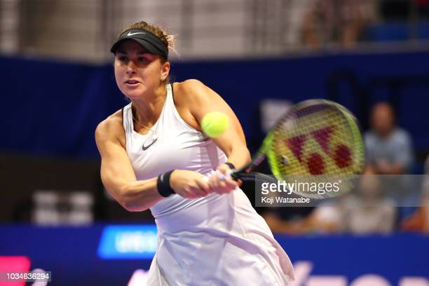Belinda Bencic of Switzerland plays a backhand during her singles first round match against Garbine Muguruza of Spainon day one of the Toray Pan...