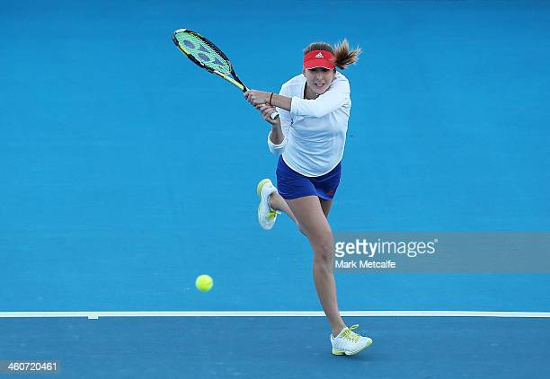 Belinda Bencic of Switzerland plays a backhand in her exhibition match with Martina Hingis of Switzerland during day one of the Moorilla Hobart...