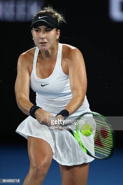 Belinda Bencic of Switzerland plays a backhand in her first round match against Venus Williams of the United States on day one of the 2018 Australian...