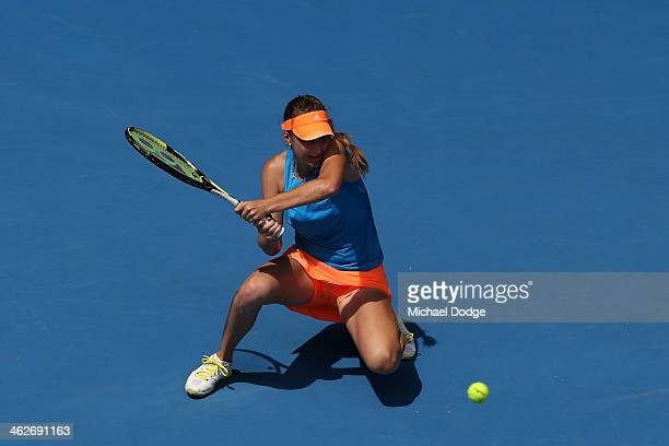 Belinda Bencic of Switzerland plays a backhand in her second round match against Na Li of China during day three of the 2014 Australian Open at...