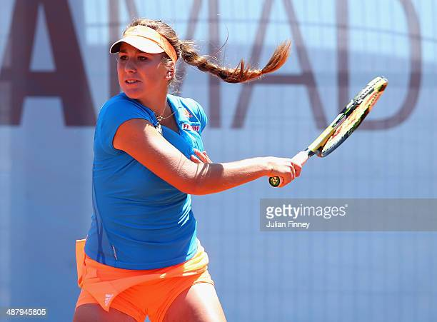 Belinda Bencic of Switzerland plays a backhand to Camila Giorgi of Italy during day one of the Mutua Madrid Open tennis tournament at the Caja Magica...
