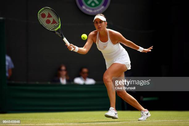 Belinda Bencic of Switzerland plays a forehand against Angelique Kerber of Germany during their Ladies' Singles fourth round match on day seven of...