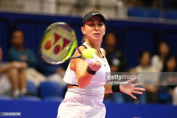 Belinda Bencic of Switzerland plays a forehand during her singles first round match against Garbine Muguruza of Spainon day one of the Toray Pan...