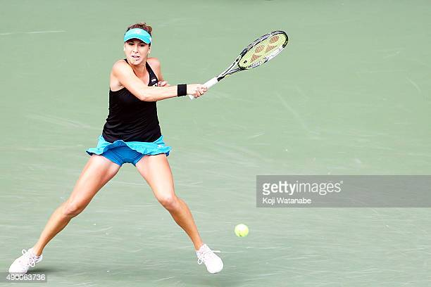 Belinda Bencic of Switzerland plays a forehand in her match against Caroline Wozniacki of Denmark during day one of the Toray Pan Pacific Open at...
