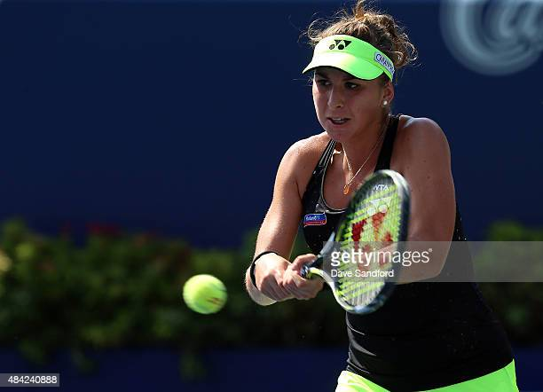 Belinda Bencic of Switzerland plays a shot against Simona Halep of Romania during the finals match on Day 7 of the Rogers Cup at the Aviva Centre on...