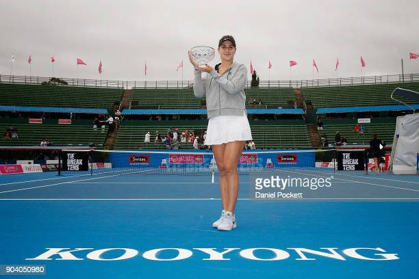 Belinda Bencic of Switzerland poses for a photo after defeating Andrea Petkovic of Germany in the Women's Singles Final during day four of the 2018...
