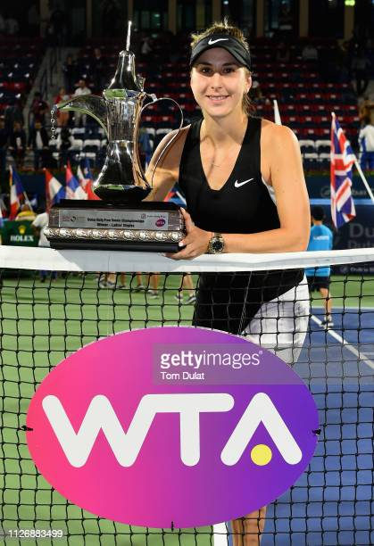 Belinda Bencic of Switzerland poses with the trophy after winning her Final Match against Petra Kvitova of Czech Republic on day seven of the Dubai...