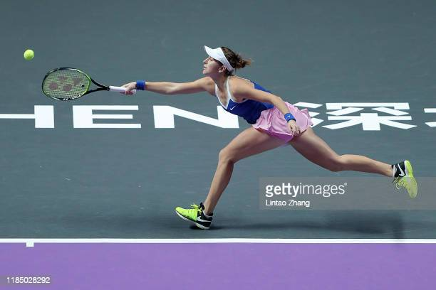Belinda Bencic of Switzerland reaches for a forehand against Elina Svitolina of Ukraine during their Women's Singles semifinal match on Day Seven of...