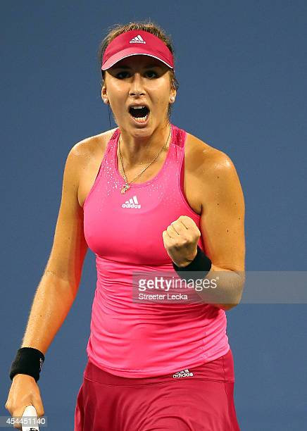 Belinda Bencic of Switzerland reacts after a point against Jelena Jankovic of Serbia during their women's singles fourth round match on Day Seven of...