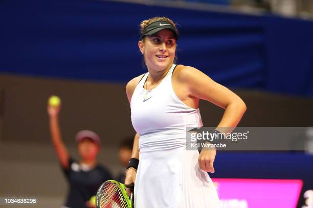 Belinda Bencic of Switzerland reacts during her singles first round match against Garbine Muguruza of Spainon day one of the Toray Pan Pacific Open...