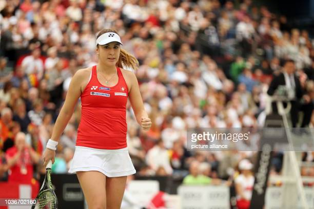 Belinda Bencic of Switzerland reacts during the match against Angelique Kerber of Germany at the Fed Cup tennis quarterfinal between Germany and...