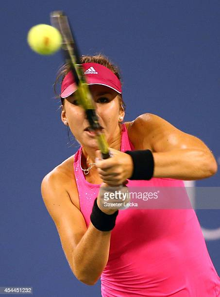 Belinda Bencic of Switzerland retuns a shot to Jelena Jankovic of Serbia during their women's singles fourth round match on Day Seven of the 2014 US...