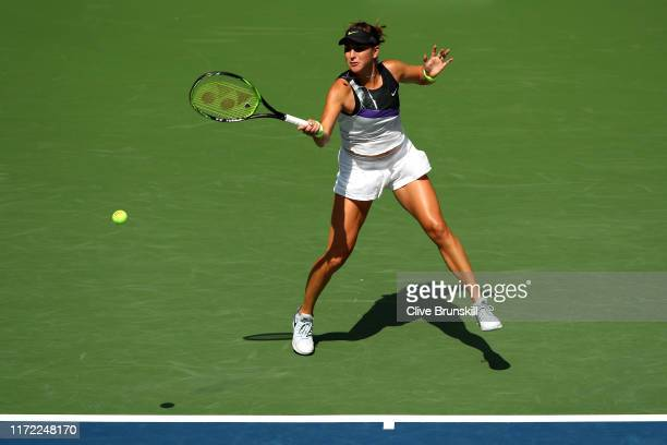 Belinda Bencic of Switzerland returns a shot during her Women's Singles quarterfinal match against Donna Vekic of Croatia on day ten of the 2019 US...
