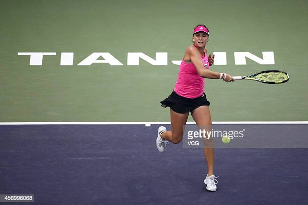 Belinda Bencic of Switzerland returns a shot in the quarterfinal match against Hsieh Su Wei of Chinese Taipei during day five of Tianjin Open at...